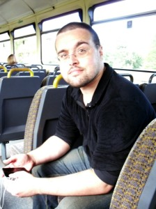 Photo of Scott sitting on the Reddish South to Denton train