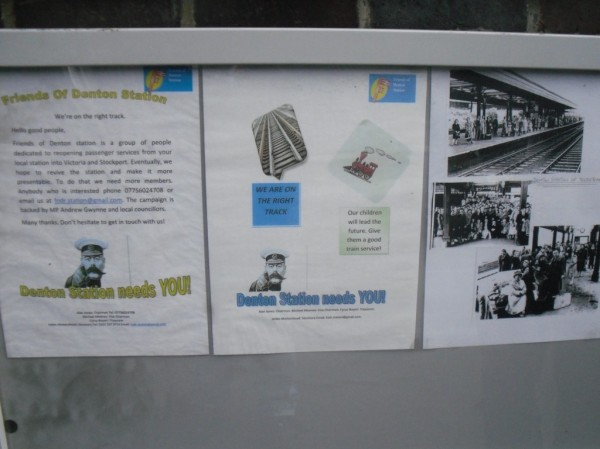 Photo of the Friends of Denton Station Noticeboard, with photos showing the station in steam days