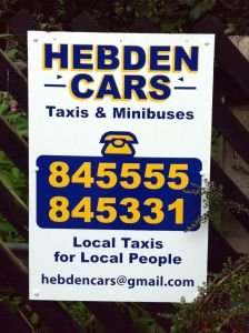 "Photo of a sign advertising Hebden Cars: ""Local Taxis for Local People"""