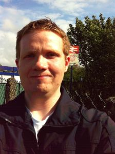 Photo of Robert in front of the Salwick Station sign