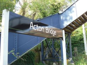 Photo of station nameboard for Acton Bridge