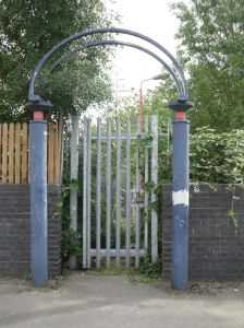 Photo of locked entrance gate to Watford West station