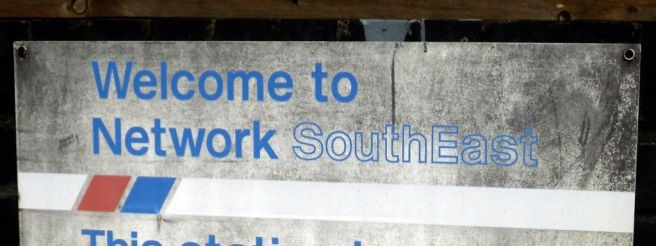 """Worn, dirty sign reading: """"Welcome to Network SouthEast"""""""