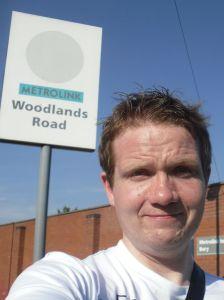 Photo of Robert Hampton in front of the Woodlands Road stop sign