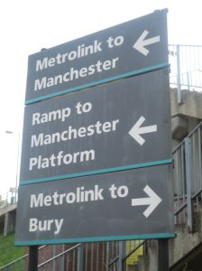 Signs at Woodlands Road pointing to Manchester and Bury platforms