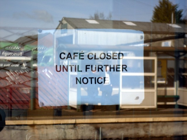 "Notice on window of cafe: ""Café closed until further notice"""