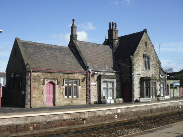 Photo of old station building on platform at Burscough Bridge
