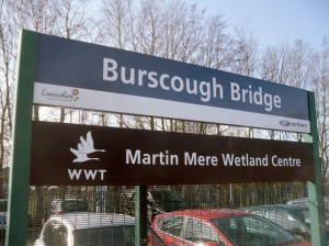 Photo of Burscough Bridge Station Sign, mentioning Martin Mere Wetland Centre