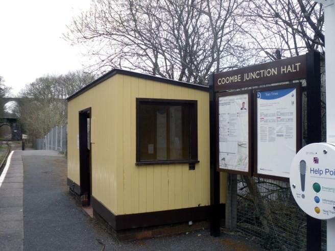 Photo of Coombe Junction Halt station showing shelter and information board