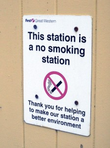 """Sign at Coombe Junction: """"This station is a no smoking station"""""""