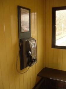 Photo of payphone inside the shelter at Coombe Junction Halt station