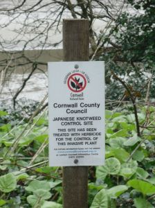 Photo of sign warning that this area has been treated with Herbicide for Japanese Knotweed