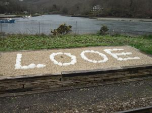 "Photo of ""Looe"" spelled out with rocks at the station"