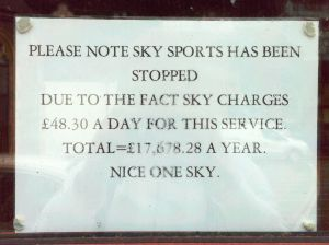 "Photo of sign in pub window: ""Please note Sky Sports has been stopped, due to the fact Sky chages £48.30 a day for this service. Nice one Sky"""