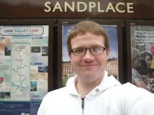 Photo of Robert in front of Sandplace station sign