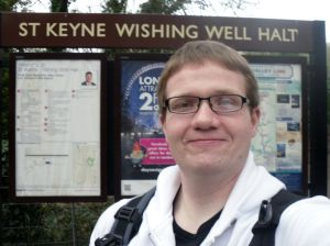 Photo of Robert posing under the St Keyne Wishing Well Halt sign