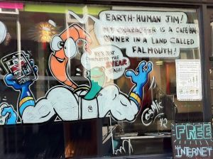 Photo of Earthworm Jim artwork outside an internet café