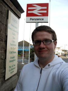 Robert standing under the Penzance sign