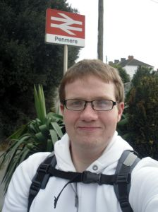 Photo of Robert with Penmere station totem in background