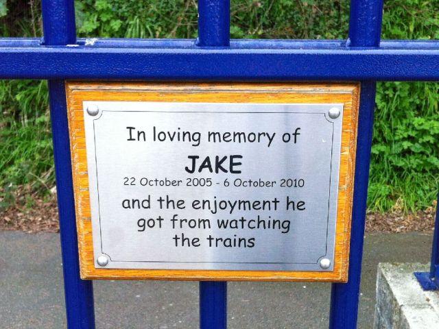 "St Ives station plaque: ""In loving memory of Jake"""