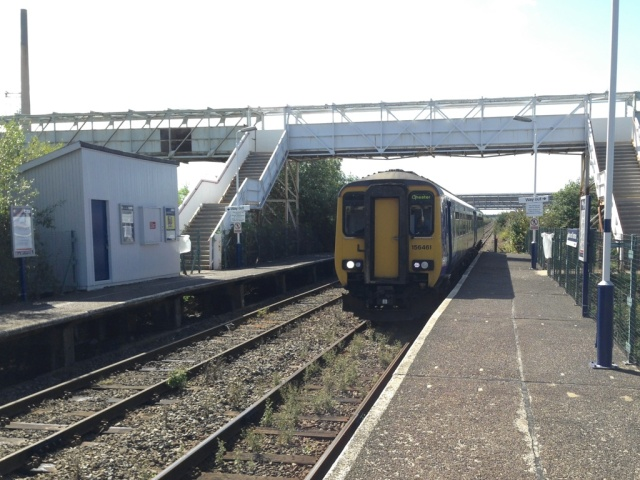 Train arrives at Stanlow & Thornton station