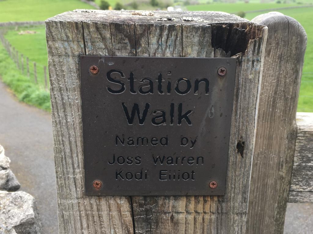 """Sign fixed to a gate post: """"Station Walk. Named by Joss Warren, Kodi Elliot"""""""